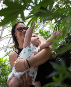 Nicole Sena has filed a lawsuit against the state Health Department, claiming its cap on the amount of marijuana that licensed medical cannabis producers can grow has led to a shortage in the cannabis oil she uses to treat her infant daughter's seizures.